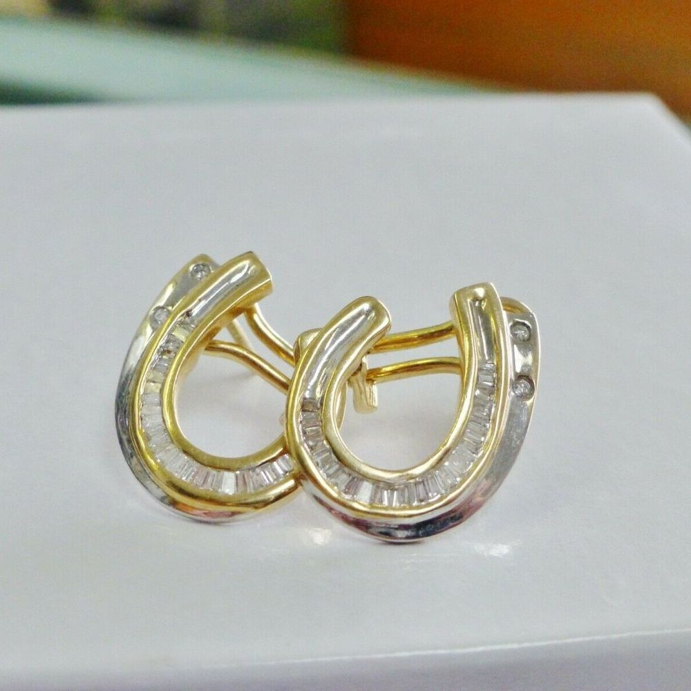 Round and baguette diamonds channel set in two tone gold horseshoe earrings