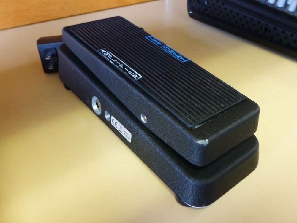 closeup picture of a black Cry Baby Wah Guitar Pedal on a shelf
