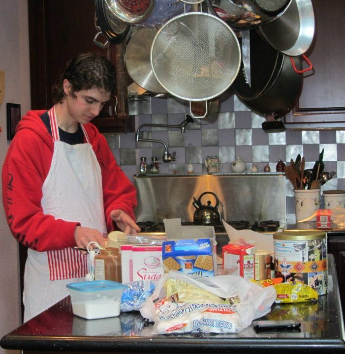 Blind young man baking Christmas cookies.