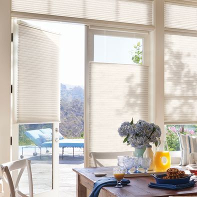 Bring summer's natural light inside on a schedule you choose when you add PowerView Motorization to Hunter Douglas shades such as these Duette Honeycomb Blinds.
