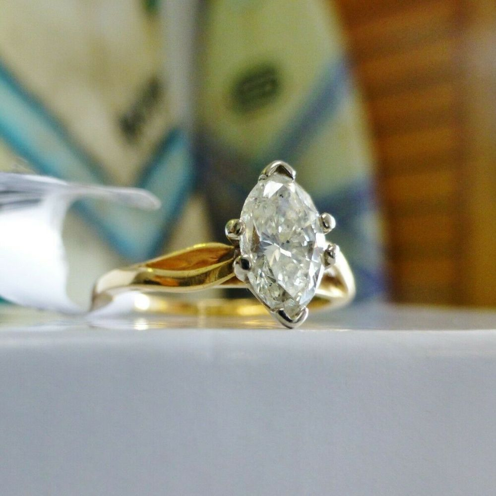 Marquise Cut Diamond Solitaire Prong Set in a yellow gold ring