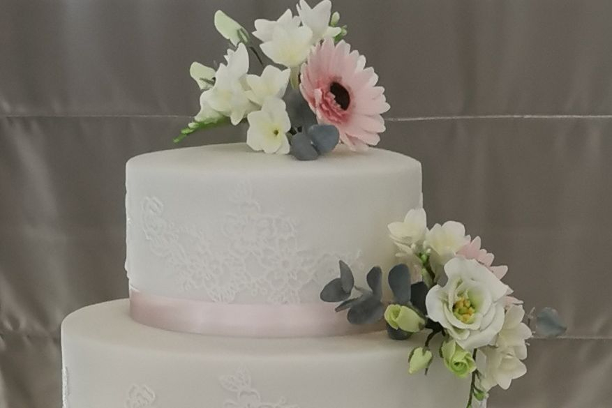 Wedding CakesThree Tiered Wedding Cake with handcrafted flowers