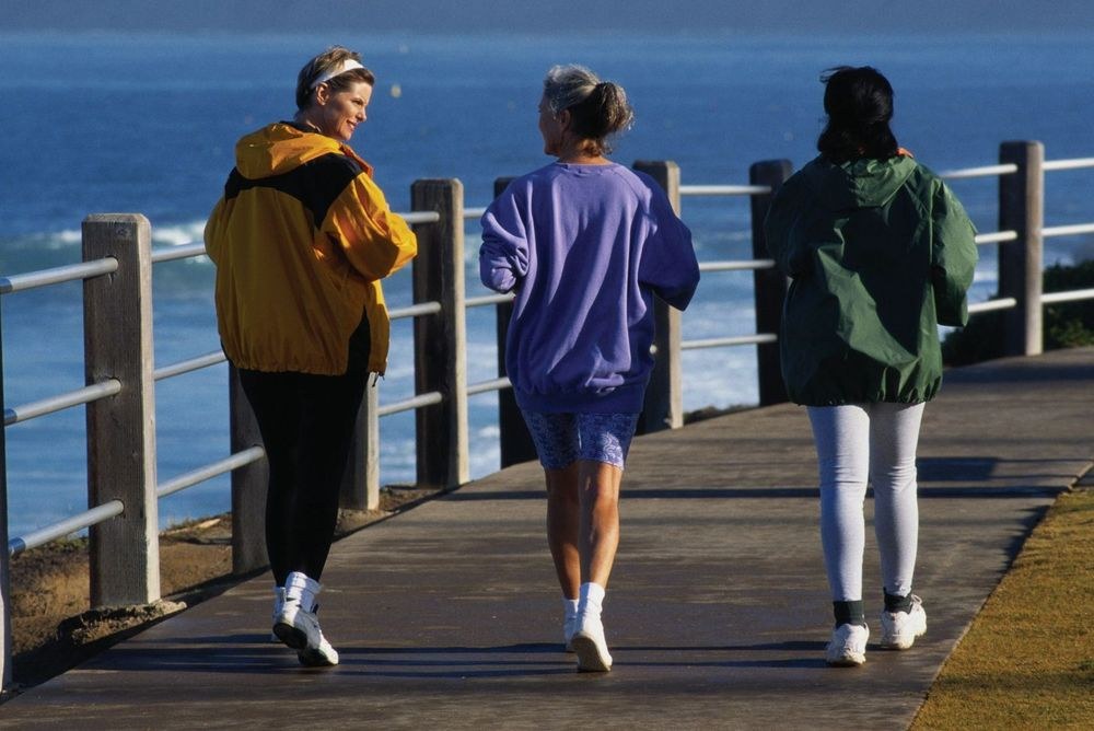 image of three woman walking on the pier exercising