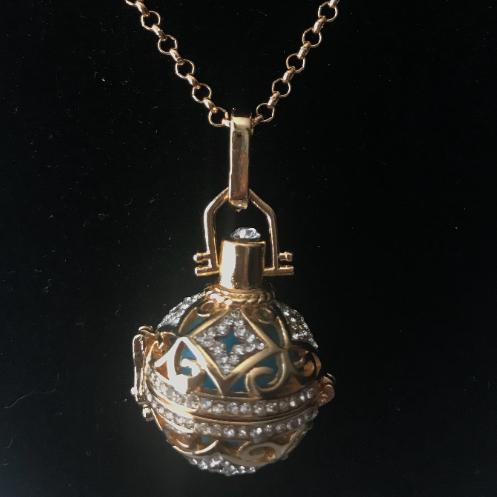 gold toned, pendant, locket, harmony ball, necklace, chain, charity, aqua, jingle, harmony, filigree