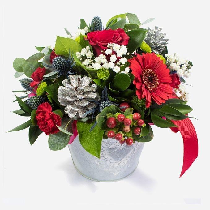 Christmas arrangement in tin bucket