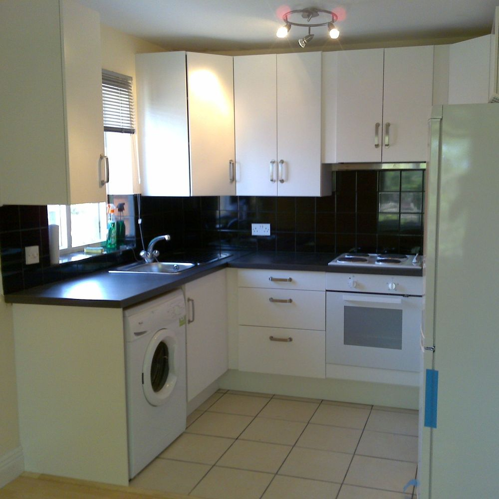 Sink, Worktop, floor tiles, Cooker, Fridge, Oven, Washing machine, Blinds, Lighting, Draws, Units, Cupboards, Wall tiles