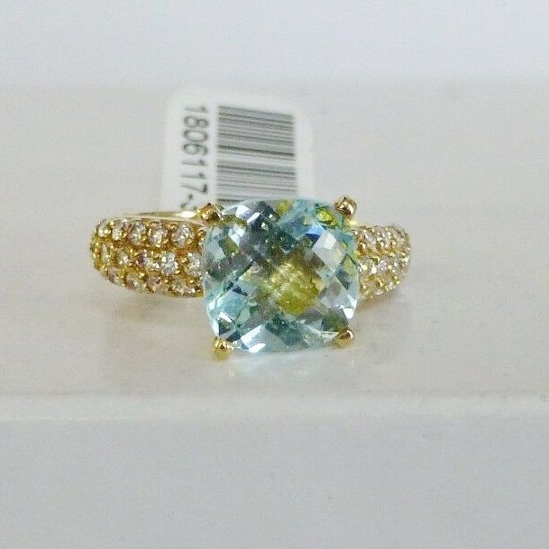 10K Yellow Gold Cushion Cut Blue Topaz Dome Style Ring With Round Diamond Accents On The Sides