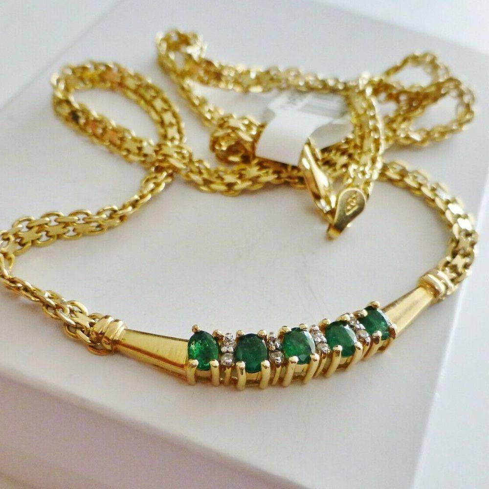 Oval Green Emerald Stone Prong set and center in a yellow gold necklace