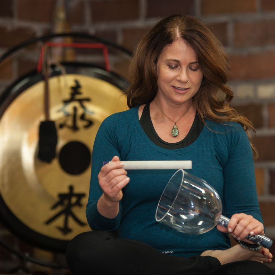 Marie with singing bowls during yoga class