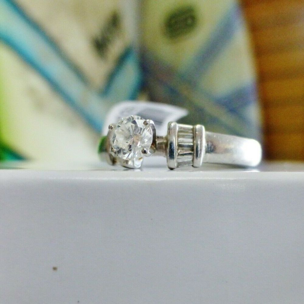 Round Solitaire Diamond with Side diamond baguette platinum engagement ring