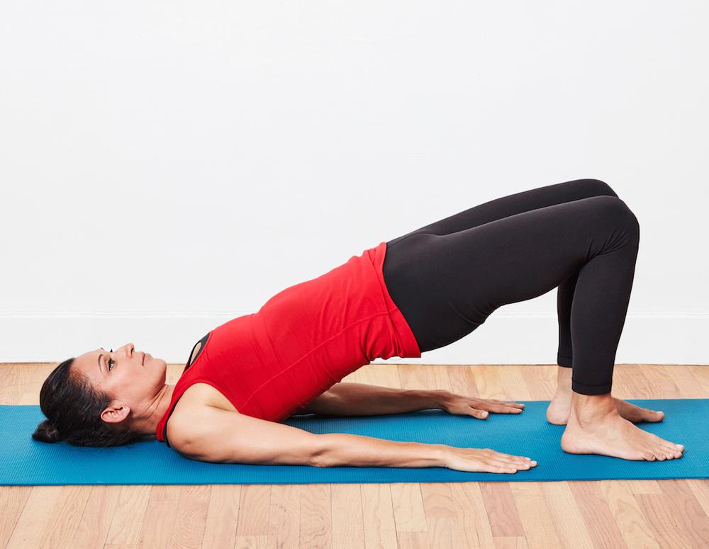Women on a mat doing her pelvic exercises
