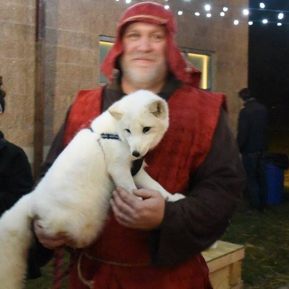Man holding an Arctic Fox