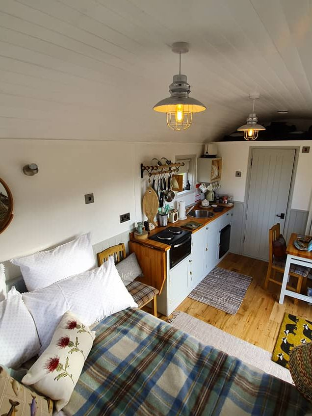 Shepherds Hut with sleeping, living, cooking, and dining facilities