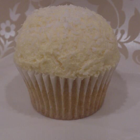 Vegan coconut bombe cupcake vanillia sponge topped with  coconut icing