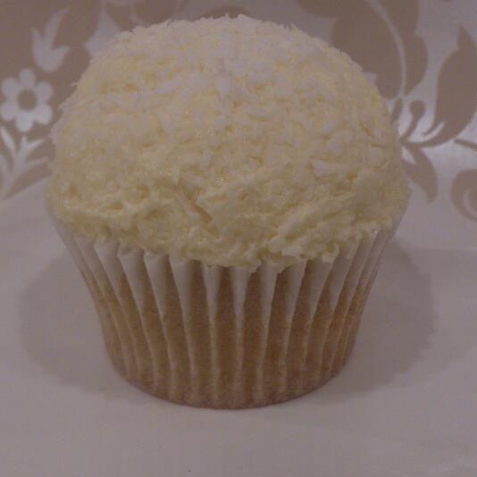 Vegan coconut bombe cupcake vanillia sponge topped with  coconut icing