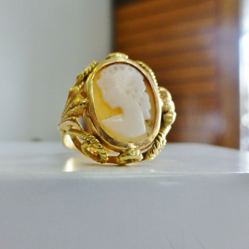 Two tone gold vintage ladies cameo ring on a white box