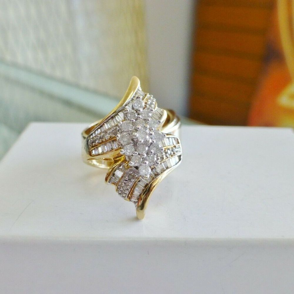 Yellow gold bypass ring with round and baguette diamonds