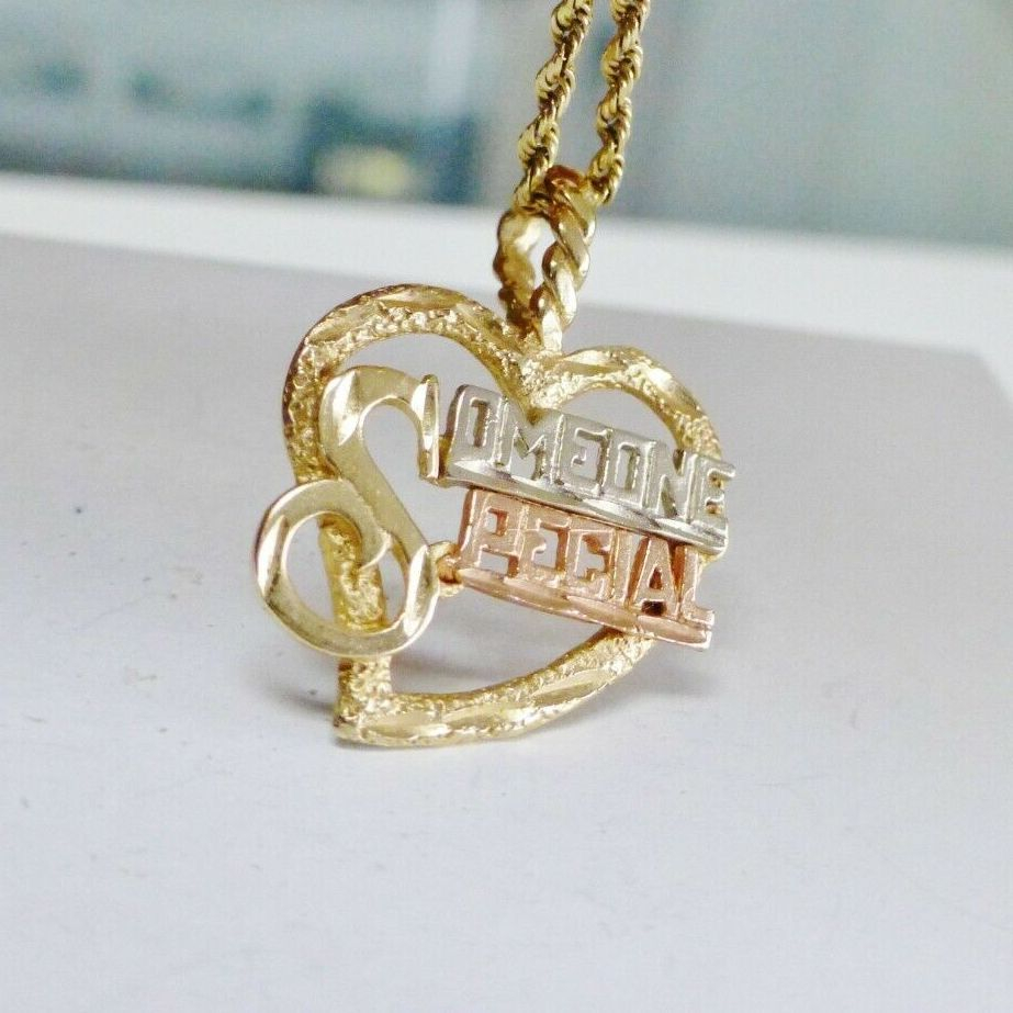 Fancy letters spelling someone special across an open heart frame charm in tri color gold