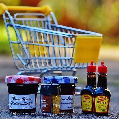 Shopping cart with groceries.