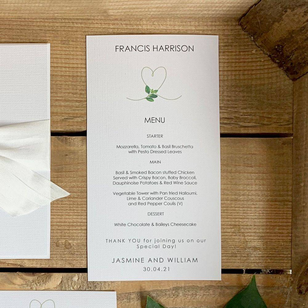Personalised wedding menu card in white with printed menu and guest name