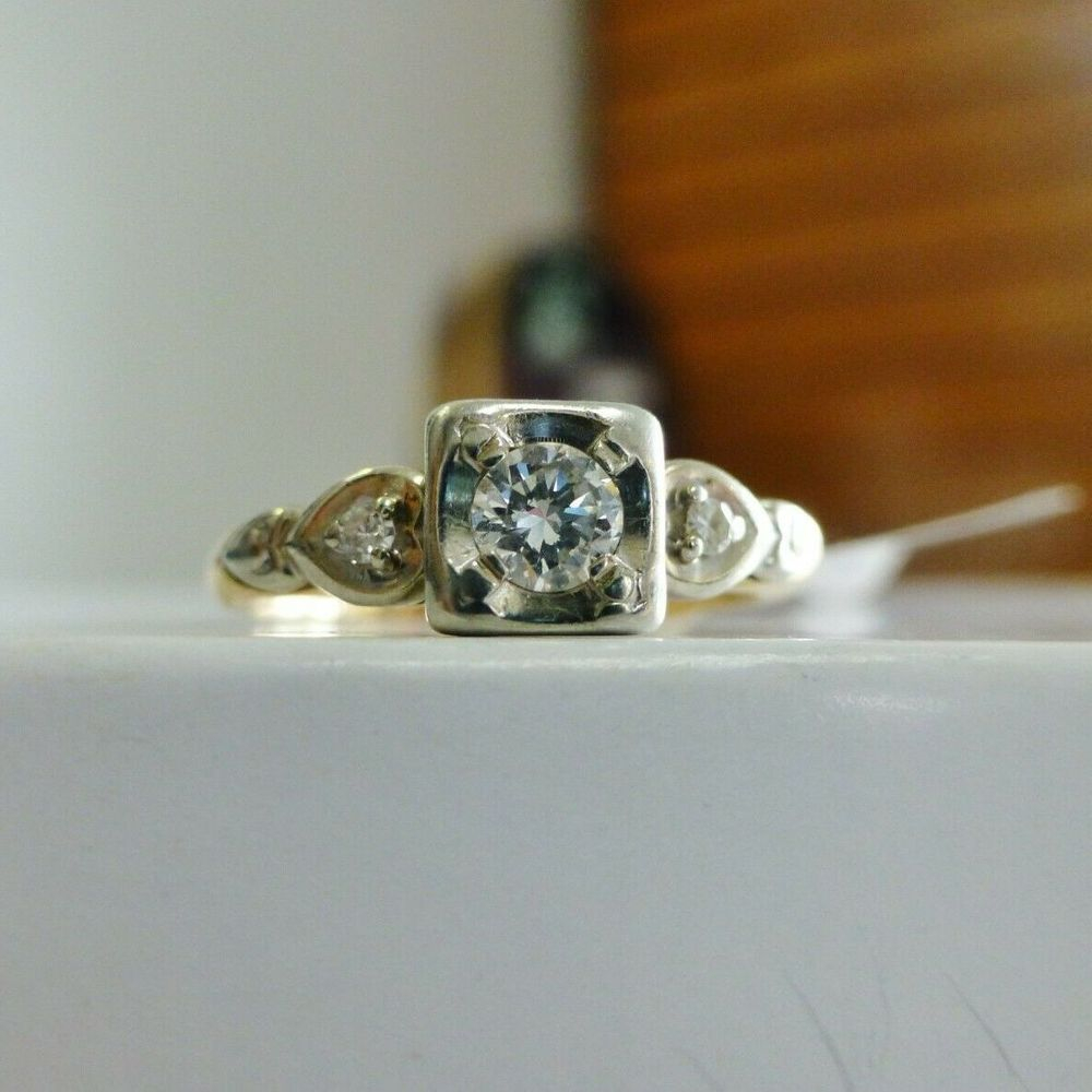 Round Cut Diamond Illusion set  atop a yellow gold art deco style ring