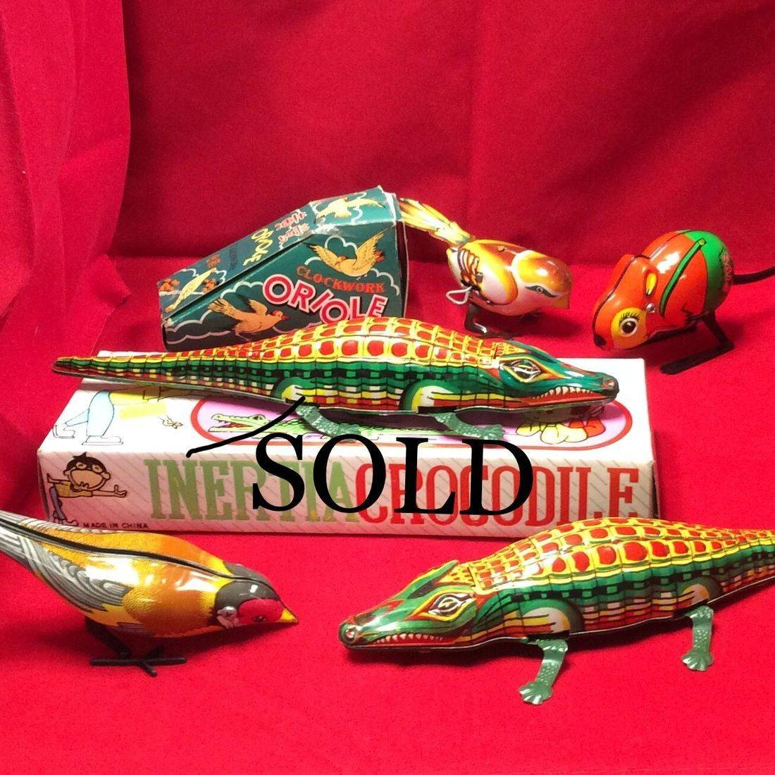 1960's Wind-up Oriole w/Box  $20  ,  1950's Wind-up Fips Mouse Germany No/Box  $25  ,  60's Friction Croc w/Box  $35  ,  60's Friction Croc No/Box  $30  ,  60's Wind-up Russian Pecking Titmouse Bird No/Box $20.00