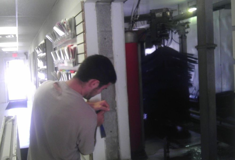 Buce repairing a leak at a carwash where a commercial window was installed improperly