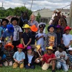 school children and horses