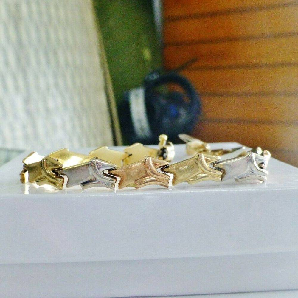 closeup picture of yellow, rose and white gold alternating link bracelet