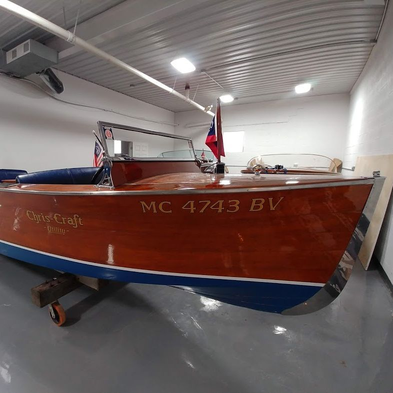 Chris craft wood boat for sale at Lake Geneva boat showroom