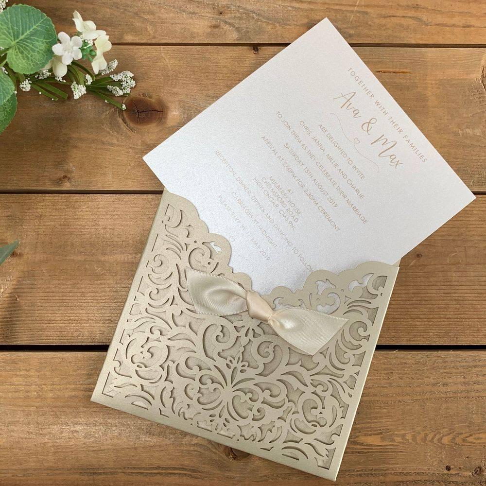 Laser cut wedding invitations in Champagne