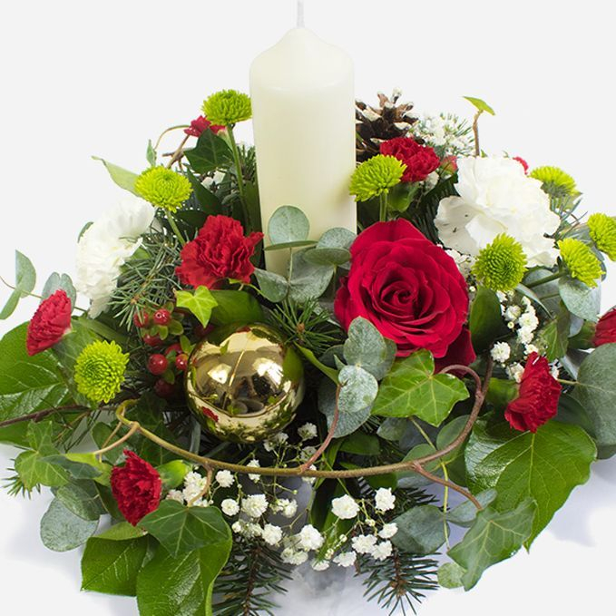 Christmas table arrangement with candle
