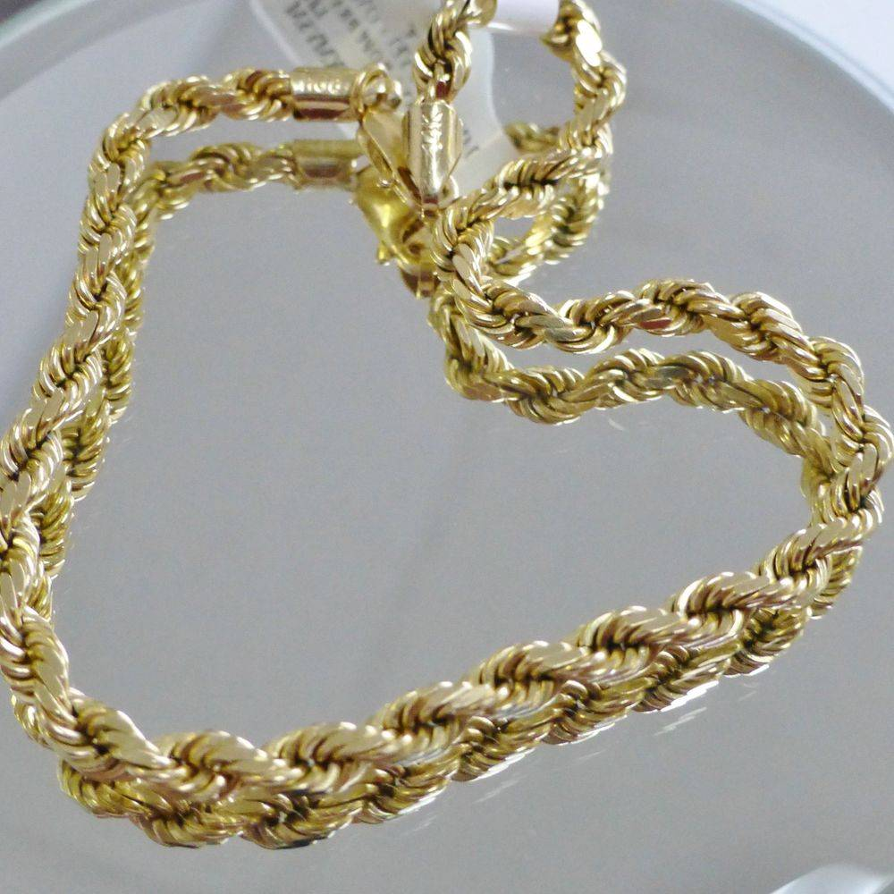 close up picture of a yellow gold men's rope bracelet