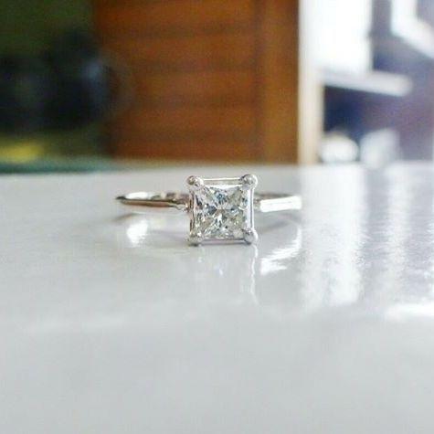 Half carat princess cut diamond solitaire prong set in 14k white gold
