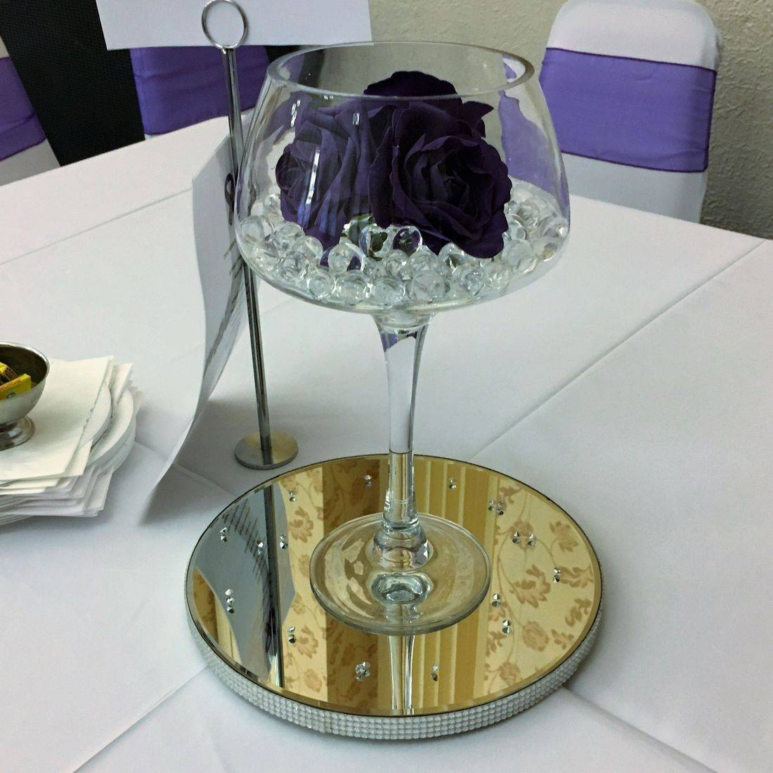Wine Goblet Centre Piece with Artificial Purple Foam Roses