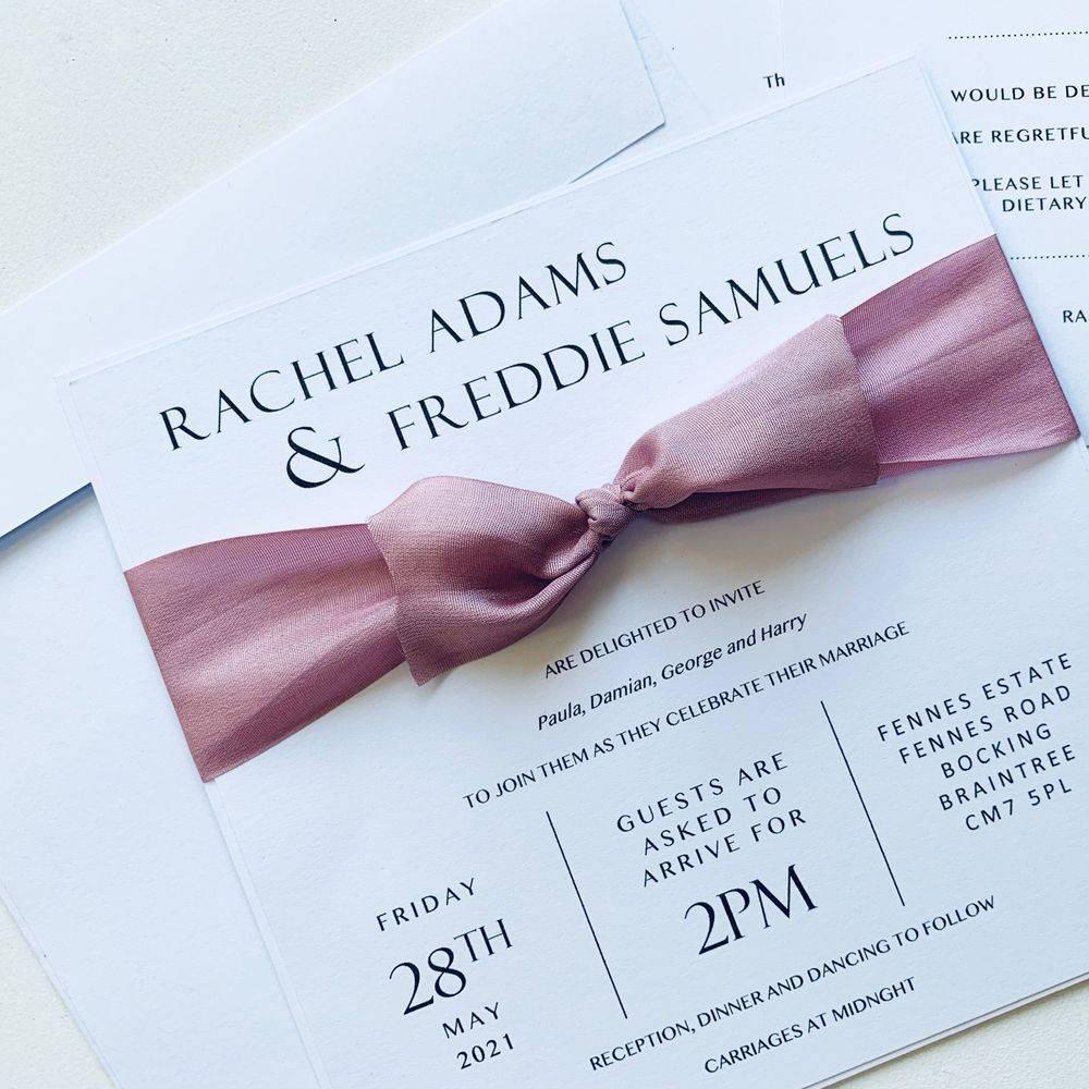 White wedding invitation with dusky pink silk ribbon