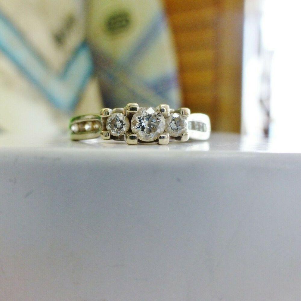 White Gold Round Cut Diamond Graduating Three Stone Engagement Ring