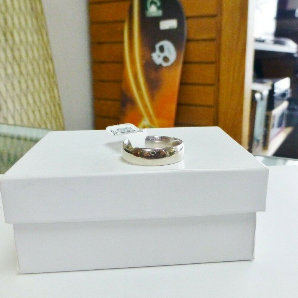 White Gold polished wedding band on a white square jewelry box
