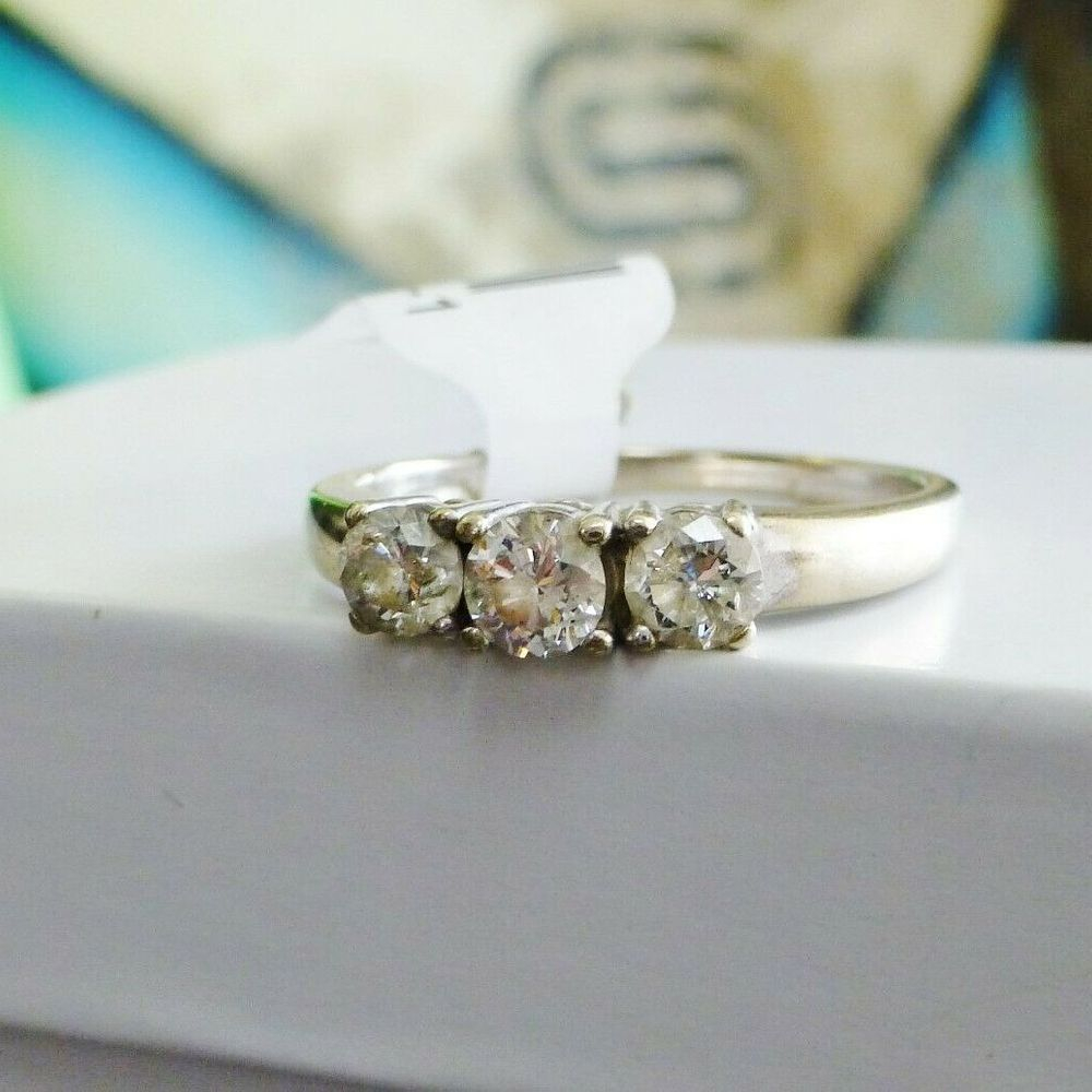 Three Round Cut Diamonds Prong Set in a white gold engagement ring