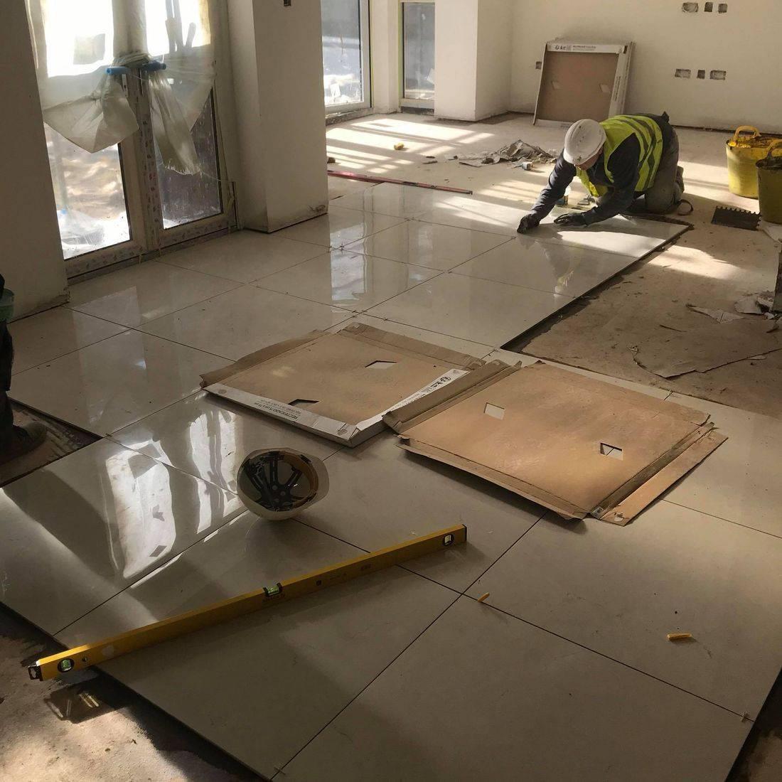 Adding floor tiles Slough