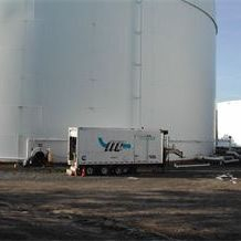 API 653 Storage Tank farm repair site Boomtrucks and skid steer for steel storage tank repair with limited access.