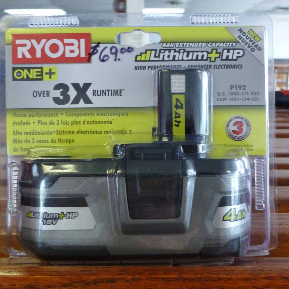 close up picture of a brand new ryobi battery in the package