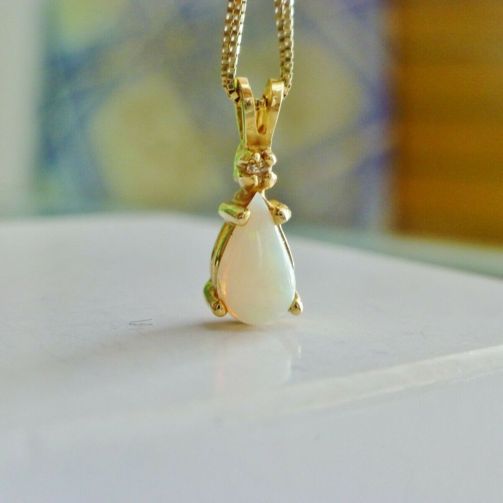 Pear Cut White Opal Pendant With Diamond Accent Charm in Yellow Gold