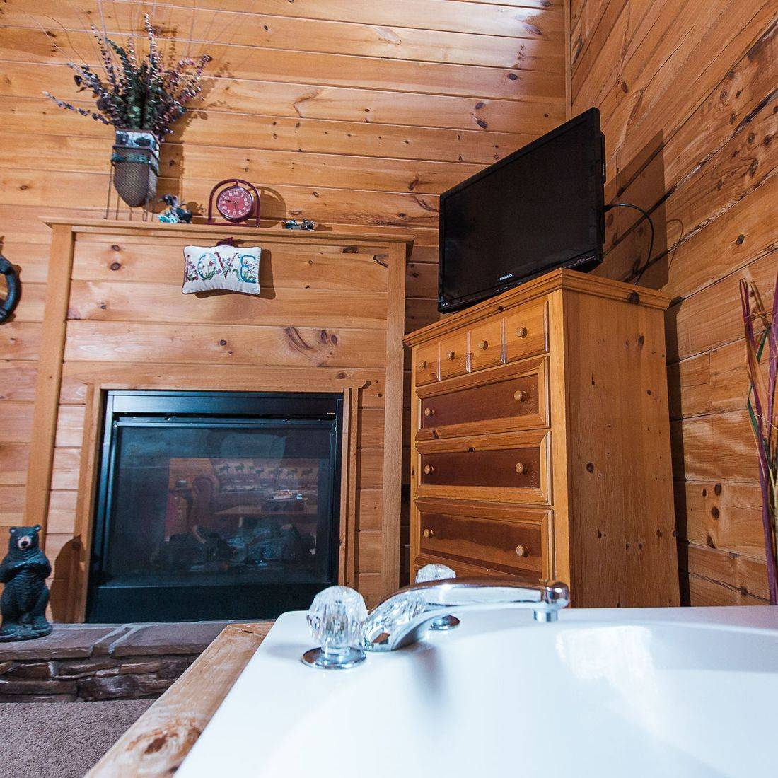Jacuzzi tub in front of gas fireplace-Gatlinburg Cabin