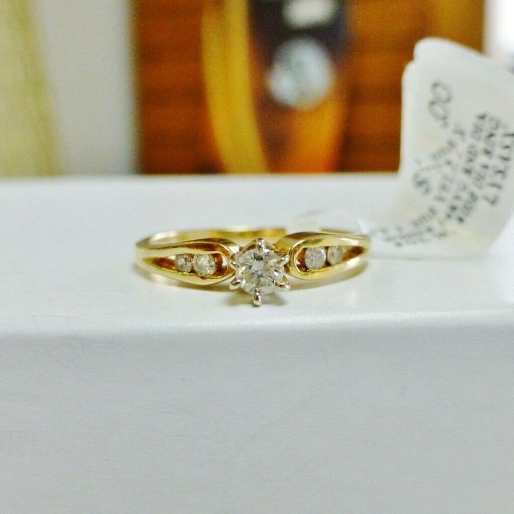 14K Yellow Gold Round Diamond Solitaire Ring with Side Diamond Accents