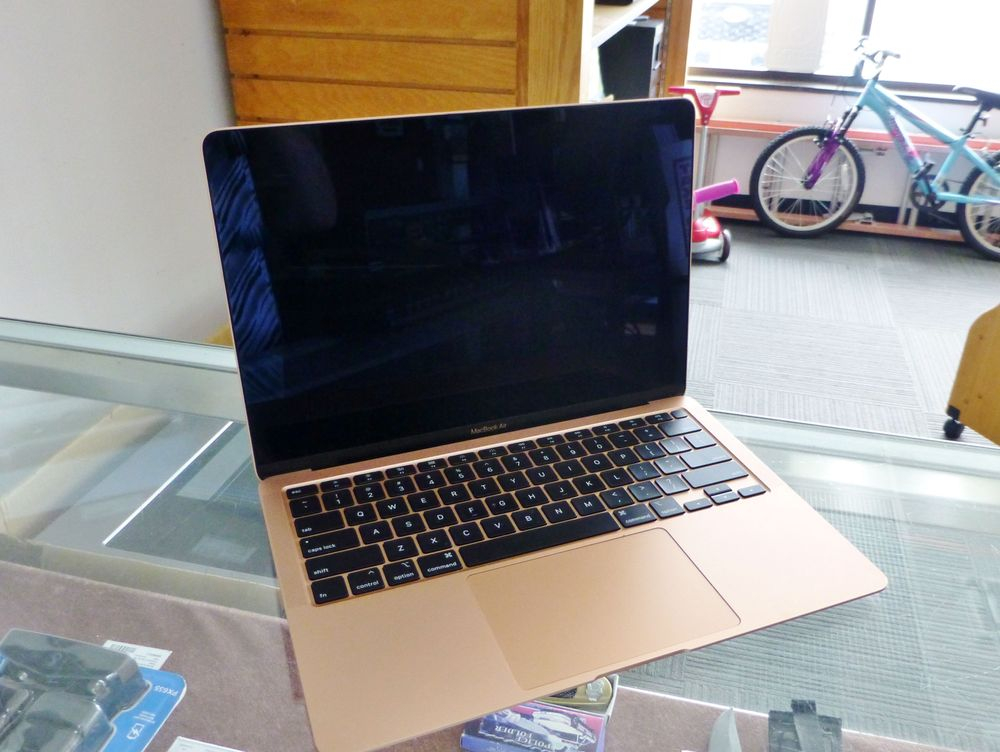 Close up picture of a rose gold Apple Macbook Air laptop