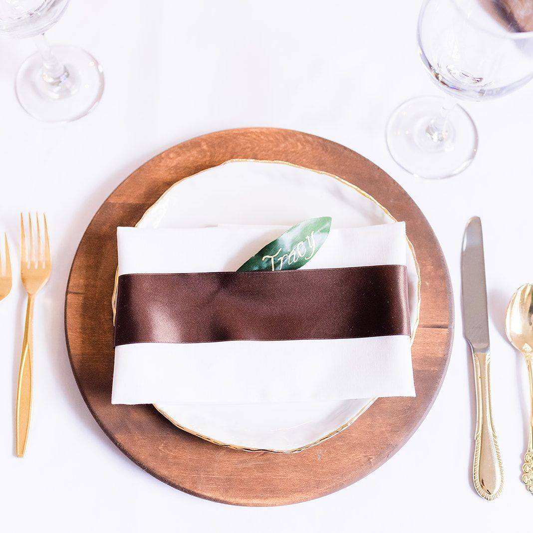 Wood wedding place setting, gold flatware, leaf place card, wood wedding decor, wood chargers, eucalyptus reception table, wedding reception table