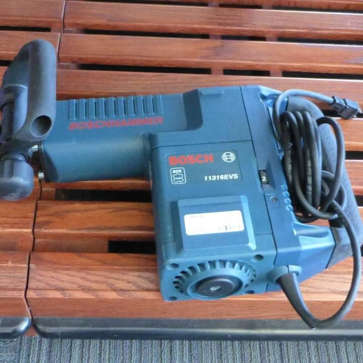 Large Blue Bosch Corded Drill on Wooden Shelf