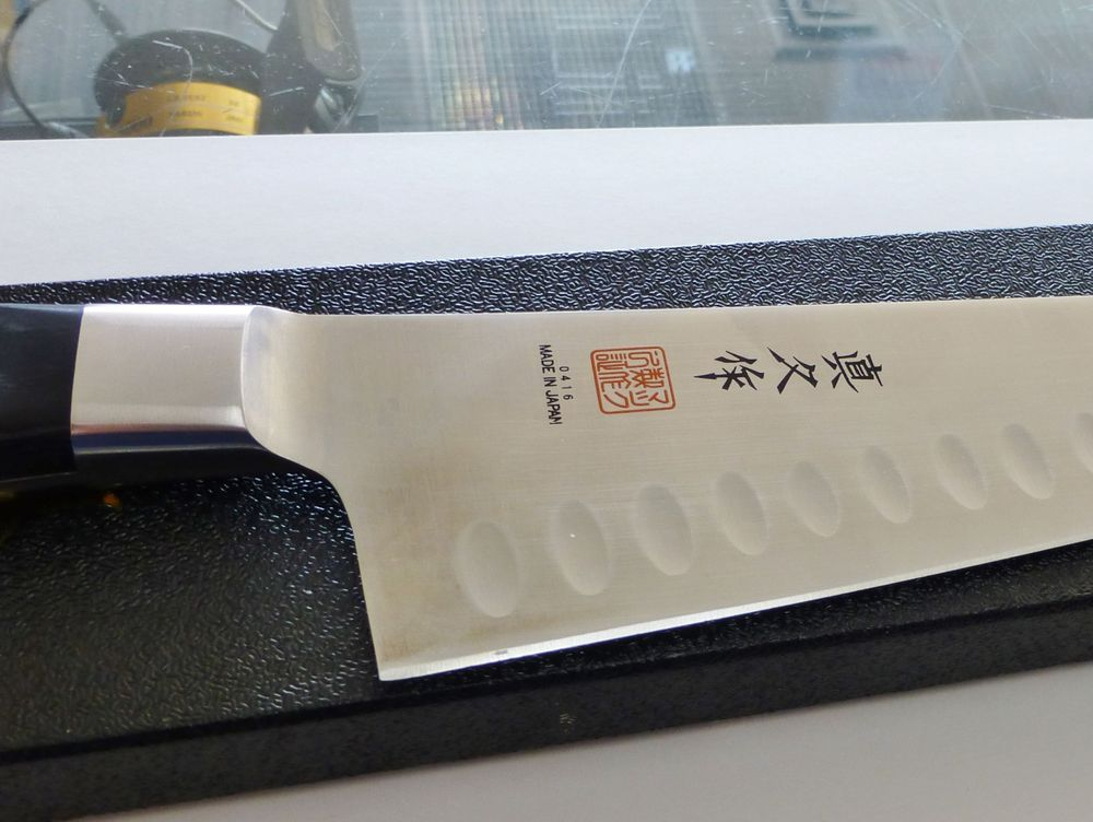 Mac Professional Chef's Knife on top of black box