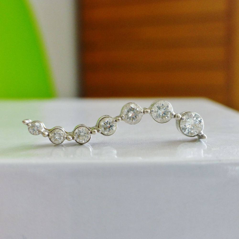 Seven Round Cut Diamond Prong Set in a White Gold Journey Pendant